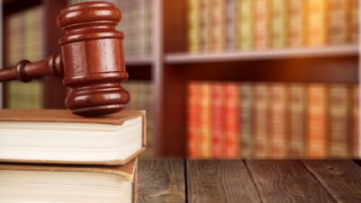 legal books and gavel in library