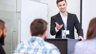 Man teaching giving speech